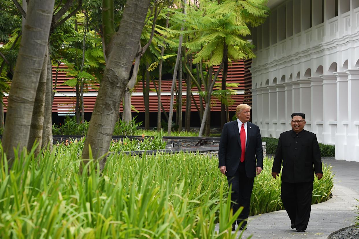 Trump and Kim walk after lunch.