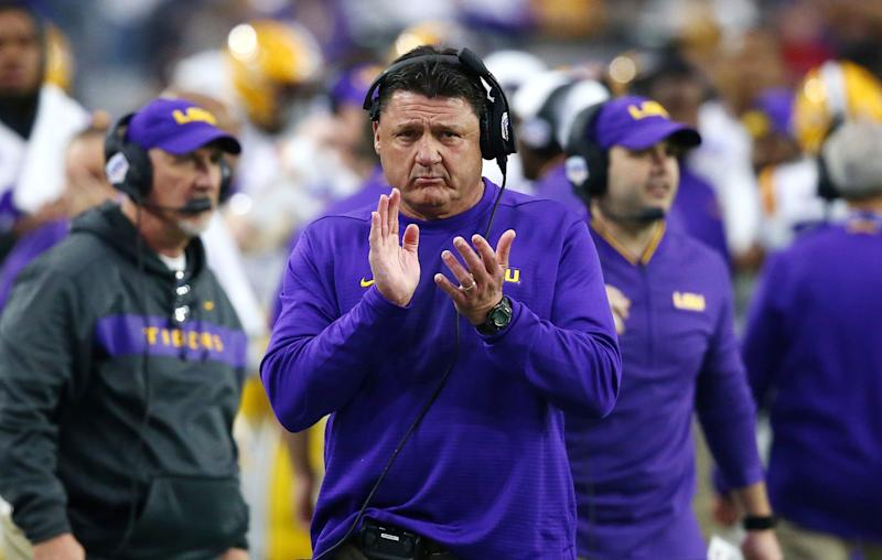 LSU head coach Ed Orgeron applauds his players during the first half against UCF in the Fiesta Bowl NCAA college football game Tuesday, Jan. 1, 2019, in Glendale, Ariz. (AP Photo/Ross D. Franklin)