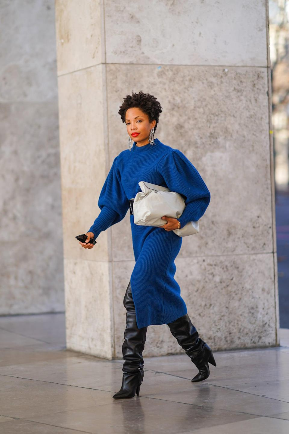 <p>Puff sleeves are still have a moment, and we can't get enough of the drama. For a cozy and stylish look, go for a thick knit dress with voluminous sleeves. Complete the look with some tall riding boots and a pouch.</p>
