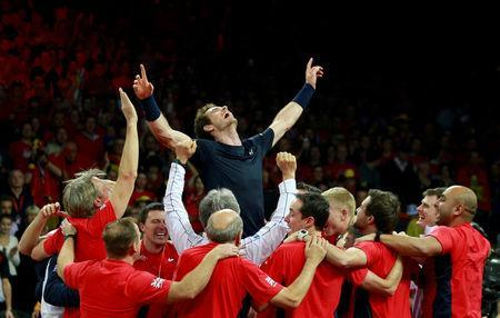 FILE PHOTO: Britain's Andy Murray celebrates with team mates after beating Belgium's David Goffin to win the Davis Cup at Flanders Expo, Ghent, Belgium - 29/11/15. Action Images via Reuters / Jason Cairnduff