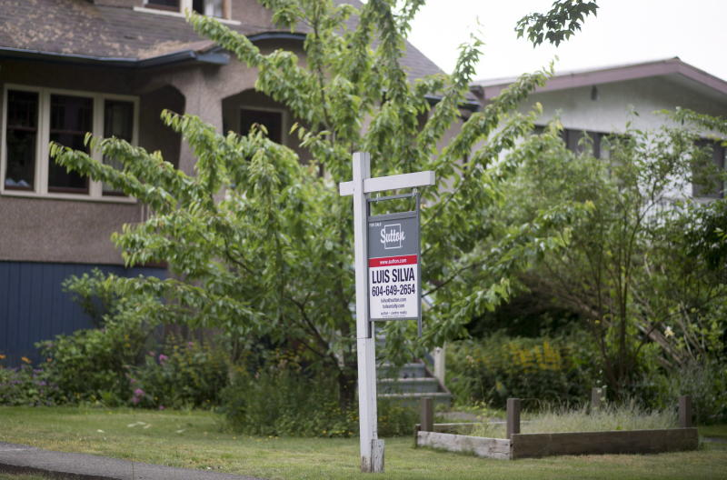 A real estate sign is pictured in Vancouver, B.C., Tuesday, June 12, 2018. THE CANADIAN PRESS Jonathan Hayward