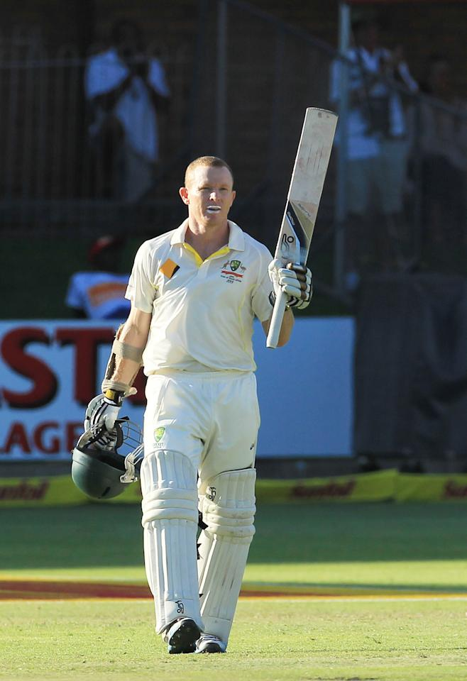 Australia's batsman Chris Rogers, raises his bat after reaching his century on the fourth day of their 2nd cricket test match against South Africa at St George's Park in Port Elizabeth, South Africa, Sunday, Feb. 23, 2014. (AP Photo/ Themba Hadebe)