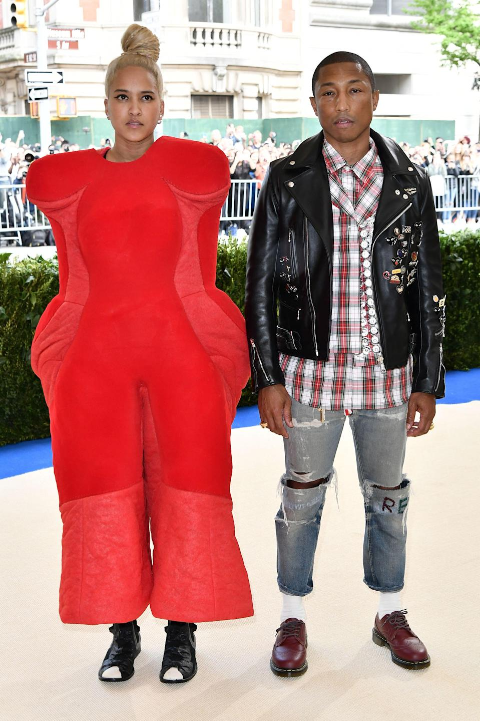 """<h1 class=""""title"""">Helen Lasichanh and Pharrell Williams in Comme des Garçons</h1> <cite class=""""credit"""">Photo: Getty Images</cite>"""