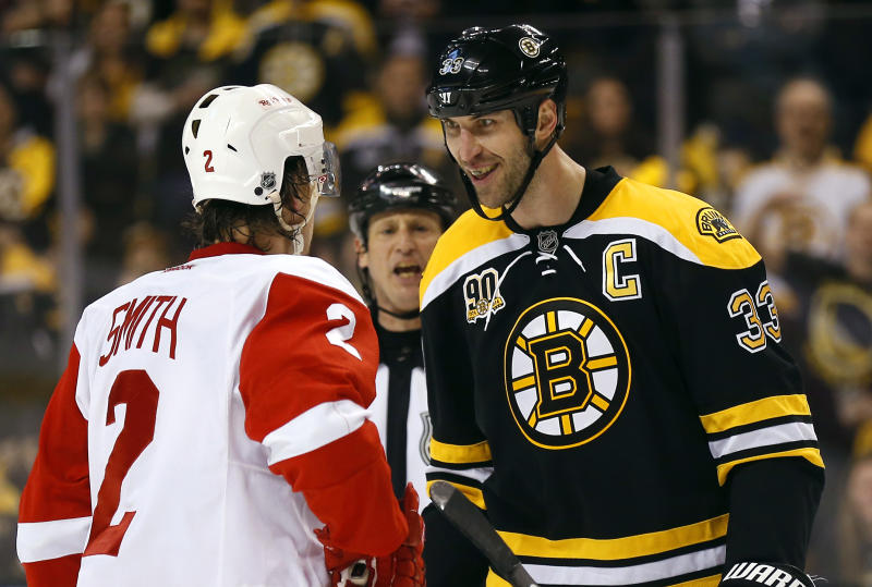 Boston Bruins' Zdeno Chara (33) stares at Detroit Red Wings' Brendan Smith during the first period of Game 2 of a first-round NHL hockey playoff series in Boston Sunday, April 20, 2014. (AP Photo/Winslow Townson)