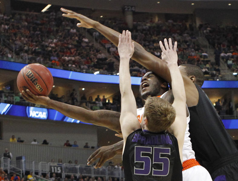 Syracuse's Dion Waiters, center, tries to shoot between Kansas State's Will Spradling (55) and Jordan Henriquez in the first half of an East Regional NCAA tournament third-round college basketball game on Saturday, March 17, 2012 in Pittsburgh. (AP Photo/Keith Srakocic)
