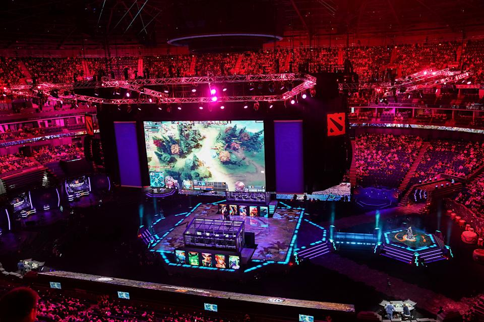 A screen shows a live image of the Dota 2 eSports Best of 5 final match between team OG and team Liquid during the International Dota 2 Championships in Shanghai on August 25, 2019. (Photo by STR / AFP) / China OUT        (Photo credit should read STR/AFP via Getty Images)