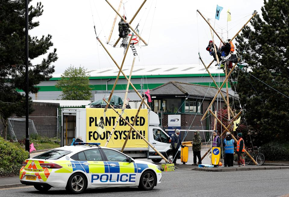 <p>Animal rights protesters blockade a McDonald's distribution centre</p> (Getty Images)