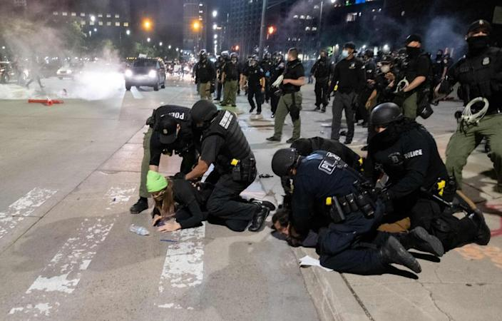 Officers arrest a protester near the police station in Detroit, Michigan, on 30 May 2020.