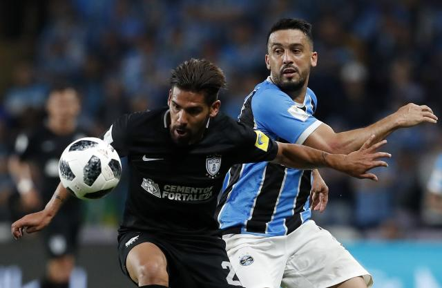 Mexico's Pachuca Franco Jara, left, and Brazil's Gremio Edilson fight the ball during the Club World Cup semifinal soccer match between Gremio and Pachuca at the Hazza Bin Zayed stadium in Al Ain, United Arab Emirates, Tuesday, Dec. 12, 2017. (AP Photo/Hassan Ammar)