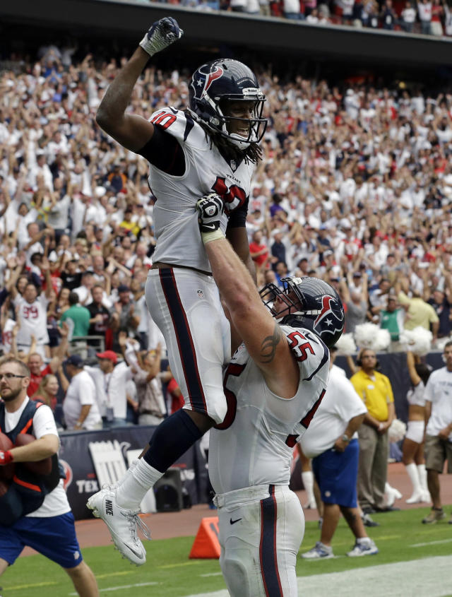 Houston Texans' DeAndre Hopkins (10) is lifted by teammate Chris Myers after scoring the winning touchdown against the Tennessee Titans during overtime of an NFL football game on Sunday, Sept. 15, 2013, in Houston. (AP Photo/David J. Phillip)