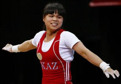 Kazakhstan's Zulfiya Chinshanlo reacts after setting new clean and jerk World record and total Olympic record on the women's 53Kg Group A weightlifting competition at the London 2012 Olympic Games July 29, 2012. (REUTERS/Kai Pfaffenbach)