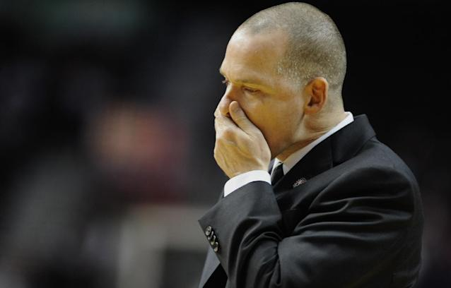 Sacramento Kings' head coach Michael Malone during a timeout against the Portland Trail Blazers during the second half of an NBA basketball game in Portland, Ore., Friday Nov 8, 2013. Portland beat Sacramento 104-91. (AP Photo/Greg Wahl-Stephens)