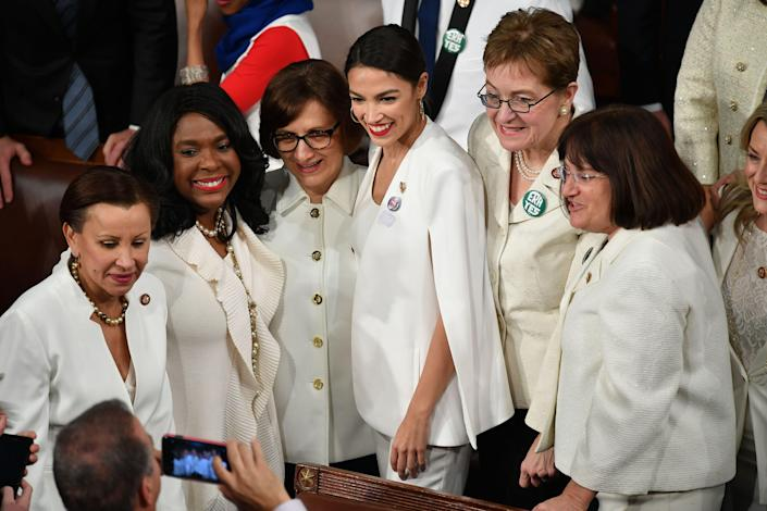 New York Representative (D) Alexandria Octavio-Cortez (C) poses for a picture with other women ahead of US President Donald Trump's State of the Union address at the US Capitol in Washington, DC, on February 5, 2019. - Women from both political parties wore white outfits tonight at the behest of the Democratic Womens Working Group to honor the legacy of women's suffrage in the United States. (Photo by MANDEL NGAN / AFP) (Photo credit should read MANDEL NGAN/AFP/Getty Images)