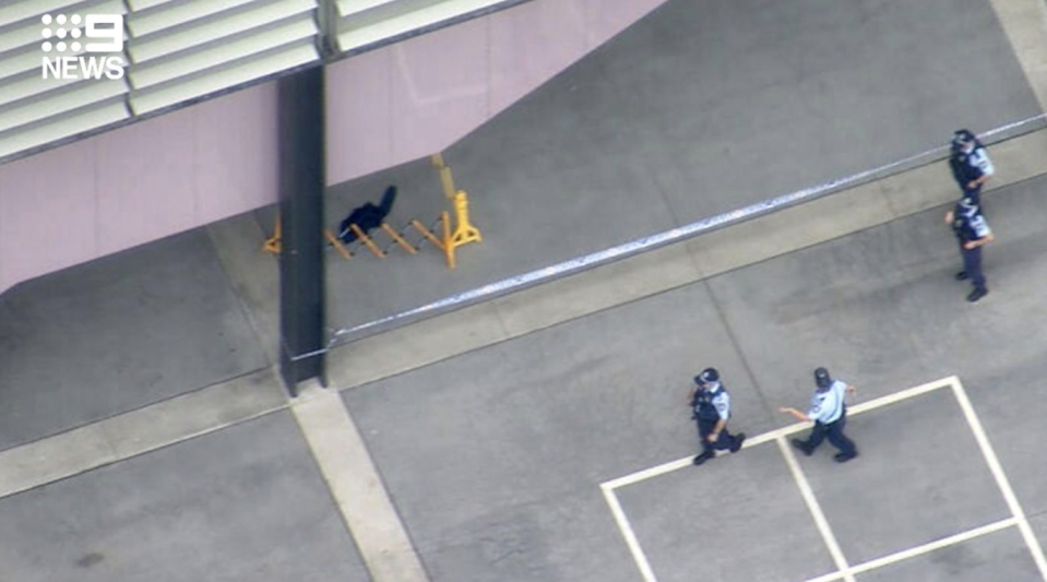 Police are seen at the school after the stabbing. Source: Nine News