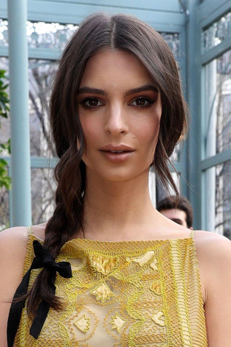 <p>Keep things simple and chic, Emily Ratajkowski accessorised her school girl plait with a black ribbon aka the hair adornment du jour.</p>
