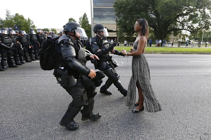 <p>JUL. 9, 2016 — A demonstrator protesting the shooting death of Alton Sterling is detained by law enforcement near the headquarters of the Baton Rouge Police Department in Baton Rouge, Louisiana. (Jonathan Bachman/Reuters) </p>