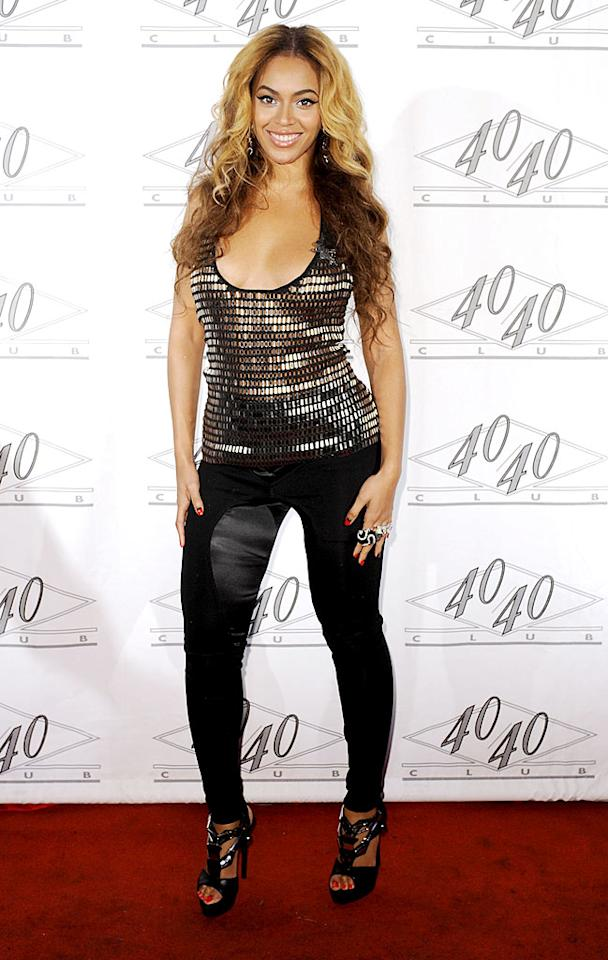 "Beyonce Knowles was smokin' in a gold sequined top and skin-tight pants at her hubby Jay-Z's Madison Square Garden concert after party in New York City. Rob Loud/<a href=""http://www.gettyimages.com/"" target=""new"">GettyImages.com</a> - March 2, 2010"