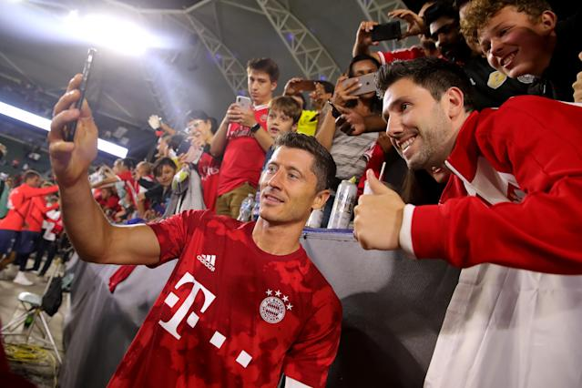 Robert Lewandowski takes a photo with Bayern Munich supporters on Wednesday in Carson, Calif. (Getty)