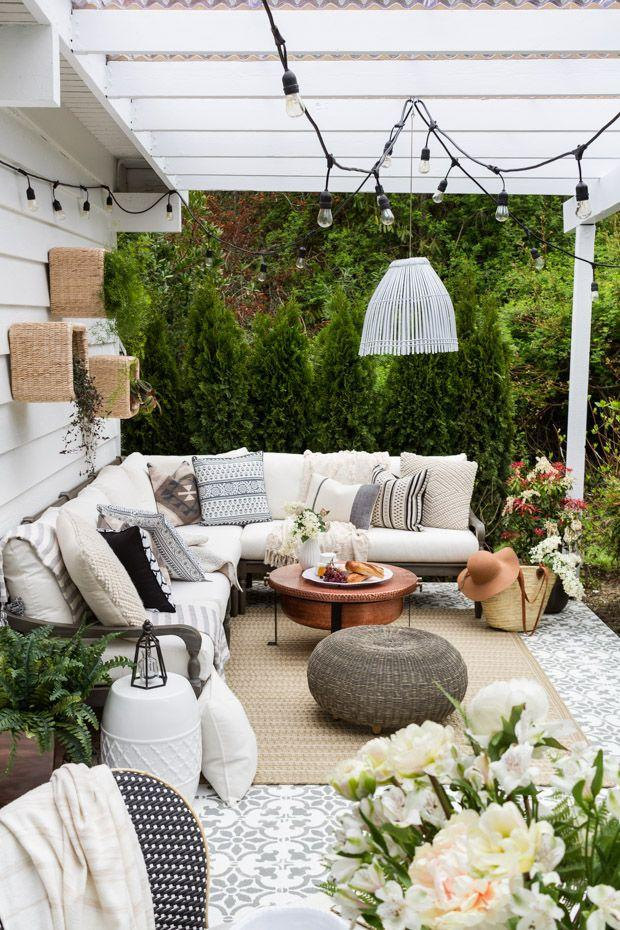 """<p>Letting your lights meet at a centered fixture will add symmetry to your space. You could use the pendant for more light or just a decoration. </p><p><strong>See more at <a href=""""https://www.zevyjoy.com/uncategorized/our-patio/"""" rel=""""nofollow noopener"""" target=""""_blank"""" data-ylk=""""slk:Zevy Joy"""" class=""""link rapid-noclick-resp"""">Zevy Joy</a>.</strong></p><p><strong><a class=""""link rapid-noclick-resp"""" href=""""https://www.amazon.com/s?k=hanging+fixture&qid=1553783493&ref=sr_pg_1&tag=syn-yahoo-20&ascsubtag=%5Bartid%7C10050.g.3404%5Bsrc%7Cyahoo-us"""" rel=""""nofollow noopener"""" target=""""_blank"""" data-ylk=""""slk:SHOP HANGING FIXTURES"""">SHOP HANGING FIXTURES</a><br></strong></p>"""
