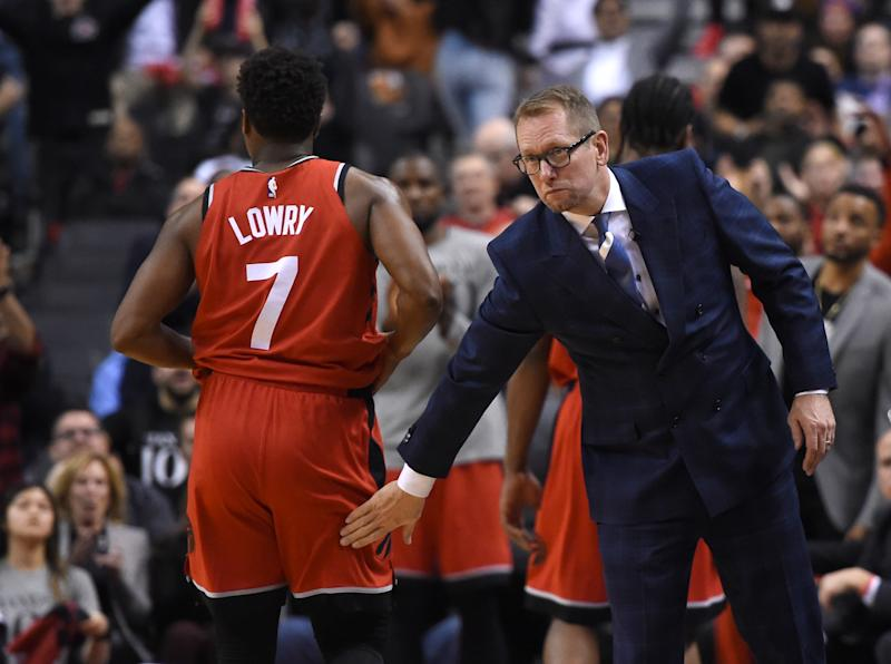 Dec 5, 2018; Toronto, Ontario, CAN; Toronto Raptors head coach Nick Nurse pats guard Kyle Lowry (7) on the backside during a time out against Philadelphia 76ers in the second half at Scotiabank Arena. Mandatory Credit: Dan Hamilton-USA TODAY Sports