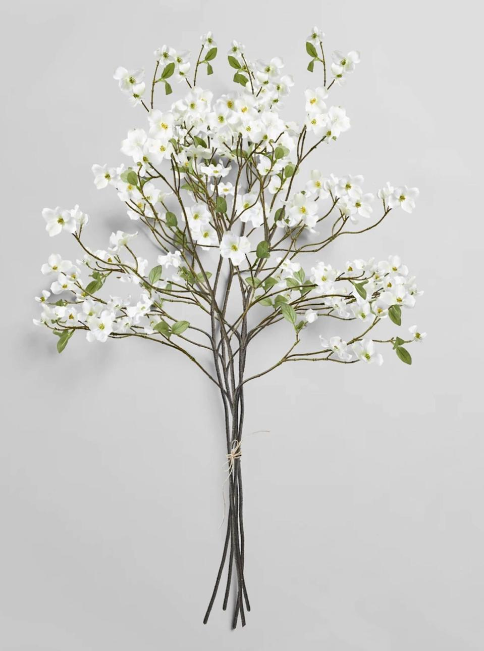 "Don't underestimate the power of a faux floral. These flowering dogwood branches are so natural-looking—they have realistic details like faded leaves and bug holes—and last years to come. They also add a sculptural element to the room when placed in a <a href=""https://www.glamour.com/gallery/cool-vases?mbid=synd_yahoo_rss"" rel=""nofollow noopener"" target=""_blank"" data-ylk=""slk:large vase"" class=""link rapid-noclick-resp"">large vase</a>. Free shipping is available on all orders over $100, and deliveries arrive within three business days. $112, Ecofaux Dogwood Bunch. <a href=""https://bloomist.com/collections/botanicals/products/ecofaux-dogwood-bunch"" rel=""nofollow noopener"" target=""_blank"" data-ylk=""slk:Get it now!"" class=""link rapid-noclick-resp"">Get it now!</a>"