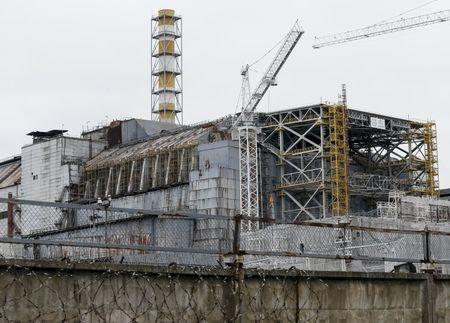 A sarcophagus covering the damaged fourth reactor is seen at the Chernobyl nuclear power plant, Ukraine, March 23, 2016. REUTERS/Gleb Garanich
