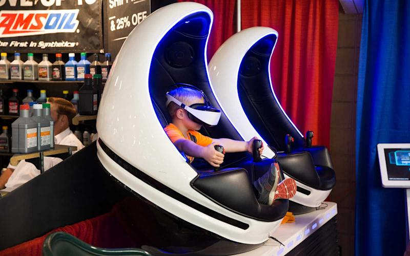 The fair isn't just about butter cows and fried food, though. Inside the exhibition hall, visitors can try out the latest in immersive VR technology. | Jason Bergman