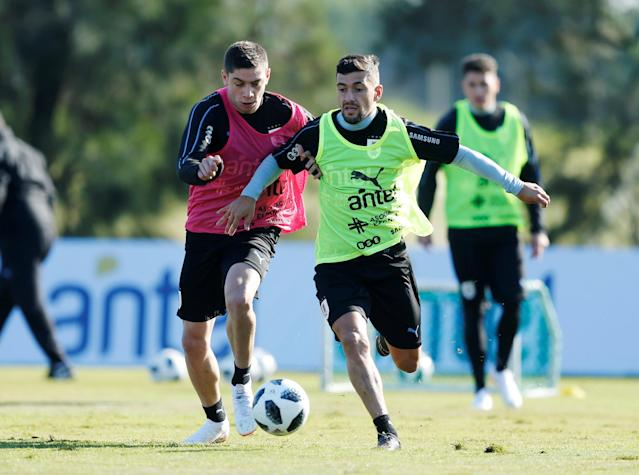 Football Soccer - World Cup 2018 - Uruguay's national soccer team training - Montevideo, Uruguay - May 24, 2018 - Giorgian De Arrascaeta and Federico Valverde of Uruguay during a training session. REUTERS/Andres Stapff