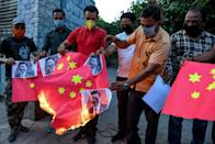 Proteters in the northern Indian city of Amritsar burn Chinese flags and pictures of Chinese President Xi Jinping in June 2020 after deadly border clashes