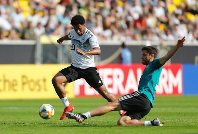 Serge Gnabry said Monday that he would love to see Germany team mate Leroy Sane move to Bayern Munich (AFP Photo/LEON KUEGELER)