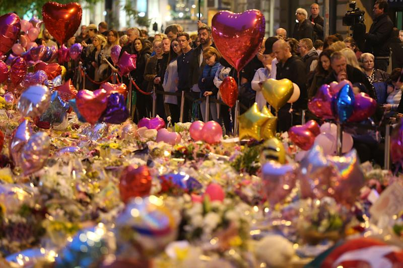 """File photo dated 29/05/17 of mourners viewing tributes in St Ann's Square, Manchester, a week after the Manchester Arena terror attack. Figen Murray, whose 29-year-old son Martyn Hett was among the 22 killed in the Manchester Arena terror attack three years ago, said she went into """"self-preservation"""" mode while sat in the Old Bailey, just metres from Hashem Abedi during his trial earlier this year."""