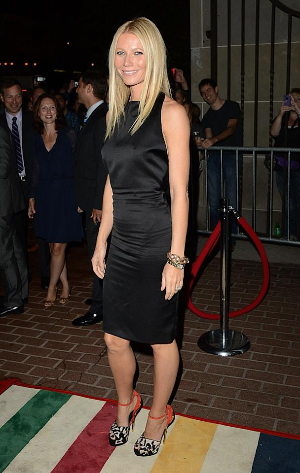 "The black Tom Ford dress Gwyneth Paltrow donned at the ""Thanks for Smoking"" debut is fine (albeit a tad wrinkly), but this outfit is all about her shoes, a coral-and-leopard pair of Giuseppe Zanotti ankle strap heels that put the focus directly on her feet. (9/8/2012)<br><br><a target=""_blank"" href=""http://omg.yahoo.com/news/gwyneth-paltrow-named-best-dressed-woman-people-magazine-101416092.html"">People names Paltrow best-dressed</a>"