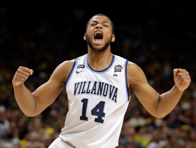 "Villanova forward <a class=""link rapid-noclick-resp"" href=""/ncaab/players/137371/"" data-ylk=""slk:Omari Spellman"">Omari Spellman</a> celebrates during the first half the Wildcats' Final Four game against Kansas. (AP)"
