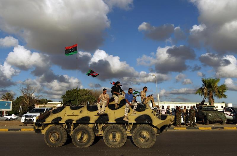 Libyan troops sit on an amoured personnel carrier on August 14, 2015 in the eastern Libyan city of Benghazi