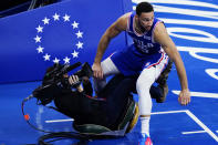 Philadelphia 76ers' Ben Simmons, right, collides with a television photographer during the second half of Game 5 in a first-round NBA basketball playoff series against the Washington Wizards, Wednesday, June 2, 2021, in Philadelphia. (AP Photo/Matt Slocum)