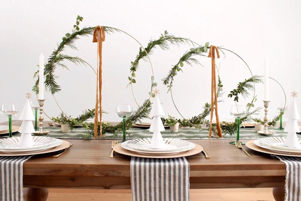 "<p>More often than not, Christmas decorations skew traditional. If you want to give your centerpiece a modern flair, try adding brass hoops like these, in varying sizes.</p><p><em><a href=""https://www.harlowandthistle.com/2019/12/modern-christmas-table-hoop-centerpiece.html"" rel=""nofollow noopener"" target=""_blank"" data-ylk=""slk:Via Harlow and Thistle"" class=""link rapid-noclick-resp"">Via Harlow and Thistle</a></em></p>"