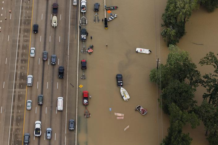 <p>Vehicles sit on the interstate 10 as it closes because portions of it is flooded, in Houston, Texas, on Aug. 29, 2017. (Photo: Marcus Yam / Los Angeles Times via Getty Images) </p>