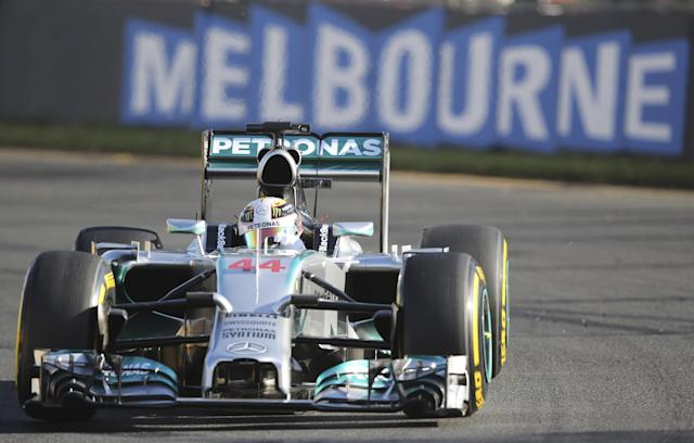 Mercedes driver Lewis Hamilton of Britain controls his car on turn five during the second practice session at Albert Park ahead of the Australian Formula One Grand Prix in Melbourne, Australia, Friday, March 14, 2014. Hamilton clocked the fastest time ahead of team mate Nico Rosberg. (AP Photo/Rob Griffith)