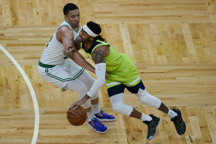 Minnesota Timberwolves guard D'Angelo Russell, right, drives against Boston Celtics forward Grant Williams in the fourth quarter of an NBA basketball game, Friday, April 9, 2021, in Boston. (AP Photo/Elise Amendola)