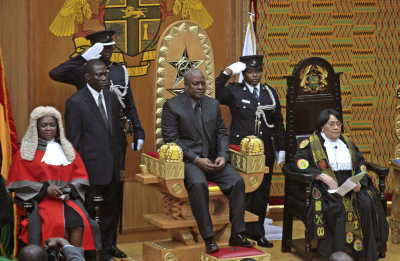 Ghana Vice President John Mahama, center, sits on a chair after being sworn in as new President of Ghana in parliament after the passing of the late Ghana President John Atta Mills in Accra, Ghana, Tuesday, July 24, 2012. President John Atta Mills' election victory secured Ghana's reputation as one of the most mature democracies in West Africa, a position further solidified Tuesday when the vice president took over only hours after the 68-year-old president died five months before finishing his first term. John Mahama's swift inauguration underscored Ghana's stability in a part of the world where the deaths of other leaders have sparked coups. (AP Photo/Christian Thompson )