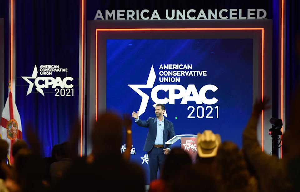 Donald Trump, Jr. waves as he leaves the stage after addressing attendees at the 2021 Conservative Political Action Conference. (Photo: Photo by Paul Hennessy/SOPA Images/LightRocket via Getty Images)
