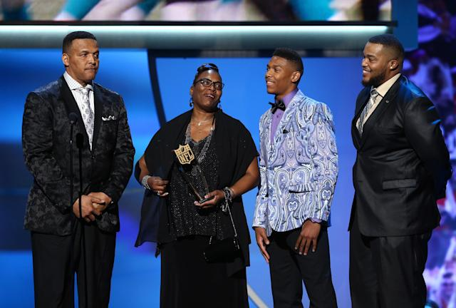 Caylin Newton, wearing the can't-miss jacket, joins his family in accepting his brother Cam's MVP award in 2016. (AP)