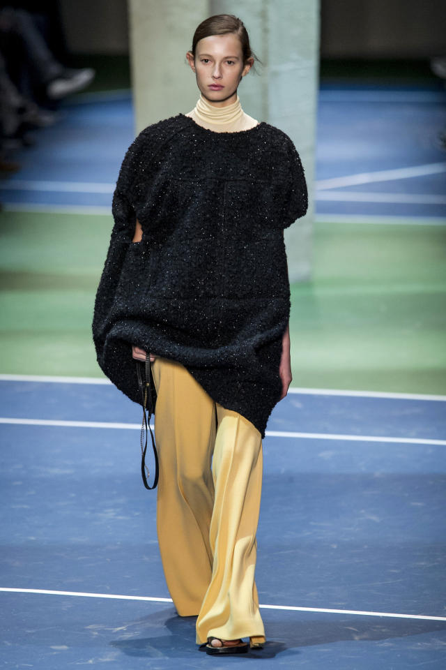 <p>A model walking during the Céline Fall 2016 show wearing a large, slightly sparkly knit you might find your grandmother wearing during the holiday season.</p><p><i>(Photo: ImaxTree)</i></p>