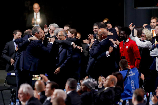 Delegates of Canada, Mexico and the United States celebrate after winning a joint bid to host the 2026 World Cup at the FIFA congress in Moscow, Russia, Wednesday, June 13, 2018. (AP Photo/Pavel Golovkin)