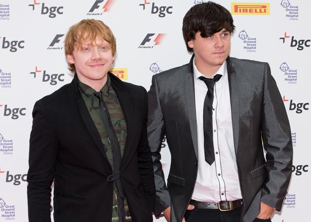 Rupert Grint introduces cute brother, James at F1 party with