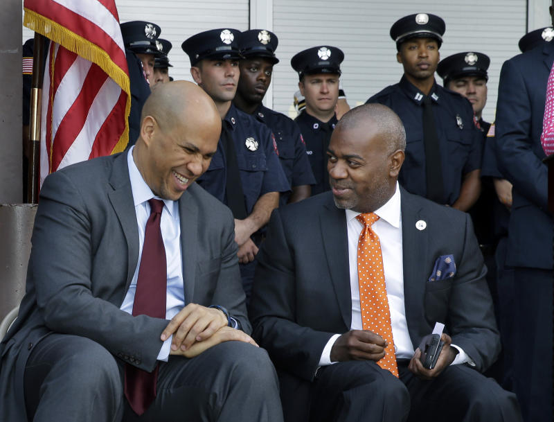 Ras Baraka, right, and former Newark Mayor, Sen. Cory Booker
