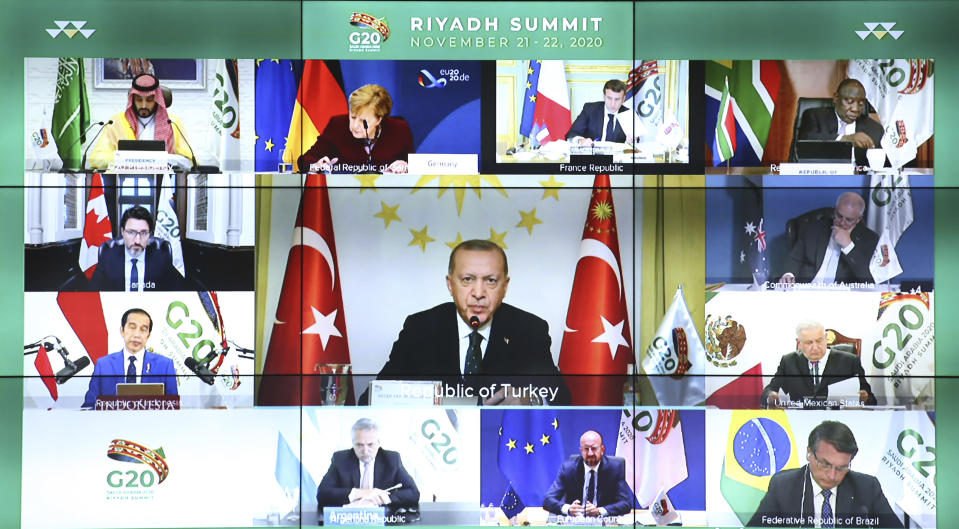 "Turkey's President Recep Tayyip Erdogan addresses the virtual G20 Leaders' Summit in Riyadh, Saudi Arabiain, in a video conference from his Vahdettin Pavilion, in Istanbul, Sunday, Nov. 22, 2020. Erdogan said Sunday that Turkey sees itself as a part of Europe, but he called on the European Union to ""keep your promises"" on issues such as the country's membership bid and refugees.(Turkish Presidency via AP, Pool)"