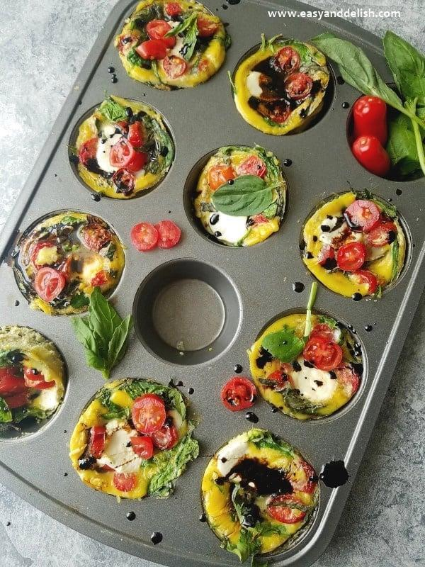 """<p>They're not just for breakfast. Try whipping up these delicious egg bites on a busy weeknight.</p> <p><strong>Get the recipe:</strong> <a href=""""https://www.easyanddelish.com/caprese-breakfast-egg-cups/"""" class=""""link rapid-noclick-resp"""" rel=""""nofollow noopener"""" target=""""_blank"""" data-ylk=""""slk:caprese breakfast egg cups"""">caprese breakfast egg cups</a></p>"""