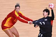 <p>Montenegro's pivot Nikolina Vukcevic (L) challenges South Korea's right back Ryu Eun-hee during the women's preliminary round group A handball match between Montenegro and South Korea of the Tokyo 2020 Olympic Games at the Yoyogi National Stadium in Tokyo on July 31, 2021. (Photo by Daniel LEAL-OLIVAS / AFP)</p>
