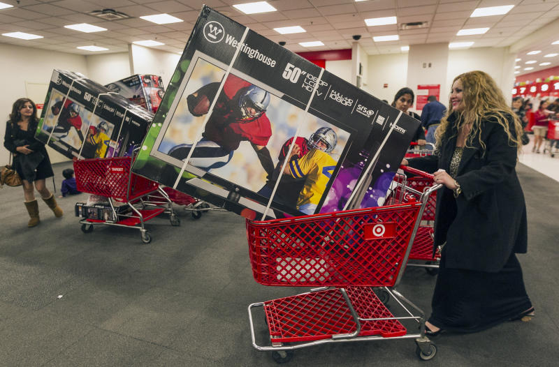 Shopper Lisa Camberos, right, gets a television doorbuster deal at the Target store in Burbank, Calif., on Thursday, Nov. 22, 2012. While stores typically open in the wee hours of the morning on the day after Thanksgiving known as Black Friday, openings have crept earlier and earlier over the past few years. Now, stores from Wal-Mart to Toys R Us are opening their doors on Thanksgiving evening, hoping Americans will be willing to shop soon after they finish their pumpkin pie. (AP Photo/Damian Dovarganes)
